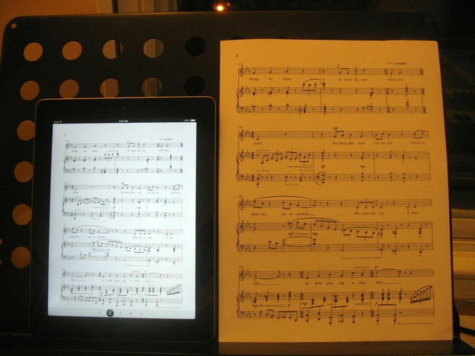 The same piece of music on an iPad and a 9x12 sheet of paper