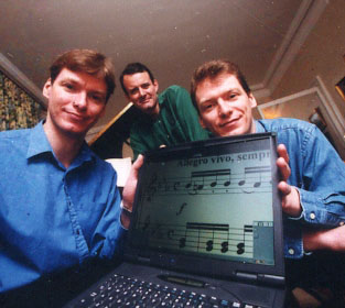 Ben and Jonathan Finn in 1999 with a representative from Quester