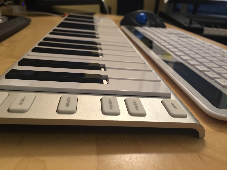 The Xkey 37 alongside my Logitech wireless keyboard and trackball